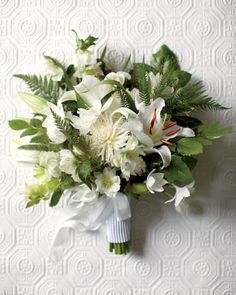 Mixed greens -- in this case, sprays of exploding grass, leaves, and ferns -- are a florist's secret weapon. Dahlias, hellebores, and 'Casablanca' and eucharis lilies shine here, though you'll get the same effect with any pale blossoms.