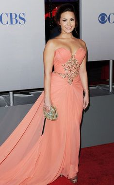 Peach Perfection from Demi Lovato's Best Looks The actress is all glamour at the 2012 People's Choice Awards wearing a strapless peach Marchesa Resort 2012 gown with a jewel-encrusted bodice.