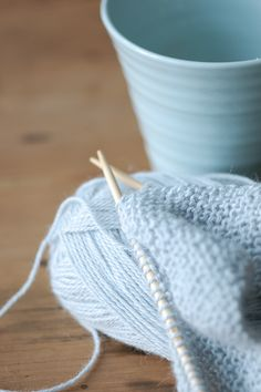 Tea and knitting in icy blue