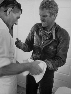 "Wincing, Steve McQueen gets his blistered hands treated in Pearblossom, Calif. Steve says of his dangerous sport, ""If you can't cut it,. Bobbers, Steeve Mac Queen, Steve Mcqueen Style, Leather Men, Leather Jacket, Biker Leather, Racing Motorcycles, Tough Guy, Good Looking Men"
