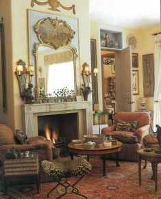 love everything going on in this room..the mirror, the fabric on the chairs and the touch of animal print