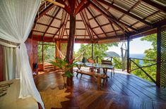 Get close to nature. Why stay anywhere else on 'Nature Island' than an open-fronted treehouse with a view of the Caribbean Sea. Caribbean Vacations, Caribbean Sea, Wooden Cottage, Sustainable Tourism, Closer To Nature, West Indies, Treehouse, Small Towns, Gazebo
