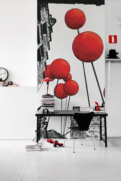 Red balloons that reach toward the sky. An intriguing angle that gives the room an unexpected view.