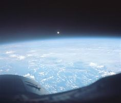 """""""I kept getting distracted by the quality and beauty of the images,"""" says Mark Robinson, who spearheaded the project to digitize the Gemini images. As a lunar scientist, he was particularly struck by this photo of a full moon over the Pacific, taken by the Gemini 7 crew. """"From a historical point of view, that was their goal,"""" he says. """"They were learning how to work and fly in space, to get to the moon. What an appropriate image this is.""""  Photo: NASA/JSC/Arizona State University"""