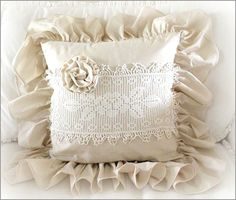 Ruffle Pillow with Rose - 45.00 ~ This is a handmade muslin pocket pillow  with a 6 inch ruffle ~  It has been embellished with a  vintage doily with a rose and a  handmade muslin rose ~  It measures 18 x 18 inches  not including the ruffle ~  The back has an invisible zipper so  the pillow form is removable ~ http://www.katiesrosecottagedesigns.com