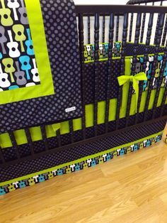 We were inspired by this pattern so we had custom quilts made by a very talented family member. Otherwise available on Etsy - Crib Bedding MADE TO ORDER Groovy Guitar Baby by LittleCharlieMay