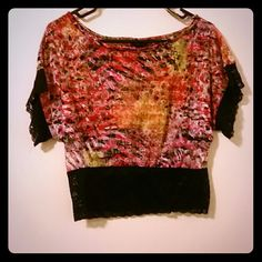 Lace Crop top with wide sleeve Beautiful crop top with several different colors pink orange green and black lace on bottom of top and at the end of the sleeves 80% Polyester 20% cotton Rue 21 Tops Crop Tops