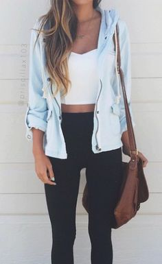 Oh yes, denim zip up jacket over chromatic black white blocked outfit with a little skin in the middle. Paired with neutral purse for classic combo.