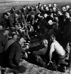 FRANCE. Arras. March 23rd, 1945. American Parachutists, with their hair cut Mohawk-style before the start of Operation Varsity - the jump that crossed the Rhine//Robert Capa