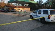 JEREMY PITTARI/PICAYUNE ITEM Pearl River County deputies who responded to a report of a shooting at this gun shop on Mississippi 43 found the store owner and his son dead in the store. Two customers, also a father and son, were shot and wounded.