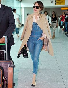 Alexa Chung in denim overalls, a classic Burberry trench coat and Chanel two-toned flats carrying a Louis Vuitton bag