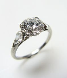 I am in the strange position of finding rings other than my Mom's to be stupendously ugly. This is one of the closest to acceptable I've found. 6 prong Tiffany setting, round stone, and tapered shoulders or a split shank are a must.