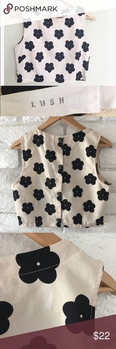 Lush floral Boxy Crop Top In preloved condition super cute and versatile crop top. A must have for all of your favorite high waisted skirts.  Color is a blush cream with black flowers. Buttons down the back. There is a white mark on the top right as shown on the photo. Fare offers welcome!! Lush Tops Crop Tops