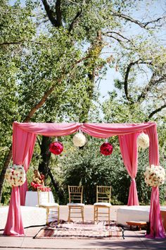 the mandap. i like the carpet, simple seating and drape of fabric; not colors or flowers
