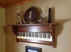 Awesome decorating idea using old piano keyboard.
