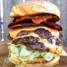 When you hear the news about and need to eat your feels with the new playing in the background. Apparently my feels taste like a triple cheeseburger is topped with crispy salami on toasted buns with burger sauce. Crazy Burger, Food Cart Design, Big Burgers, Tasty, Yummy Food, Best Food Ever, Food Goals, Sandwiches, Food Cravings