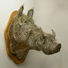 Lesley D. McKenzie-Wirehog Fused Wire Sculpture This is worth trying!  Measure the real thing for dimension and photograph it from all angles then 'draw' it in wire!