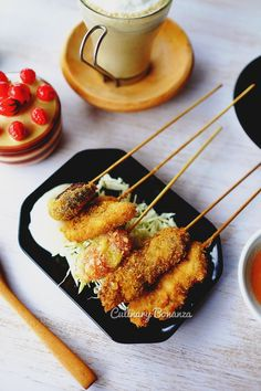 Kushikatsu Set C (Chicken, Beef, Spicy Lotus Root, Spicy Shiitake Chicken, Tomato Cheese) -Japanese style of deep fried meat or vegetables on skewers, served with the special dipping sauce