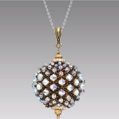 Bella Bead by pencio, made into a pendant with Swarovski crystals. Pattern at http://biser.info/node/44031?page=2.