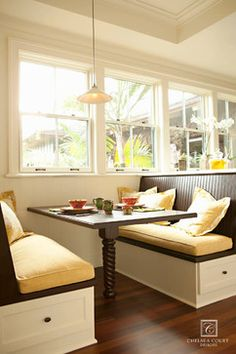 Breakfast nook. Love the light and bright with the dark stain.