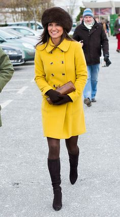 Pippa looked cozy at the Cheltenham Festivalin aKatherine Hooker mustard yellow coat and the same Aquatalia boots her sister Kate loves. via StyleList