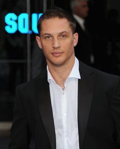 Tom Hardy. Again, hot man with tattoos, but I figured I may as well post at least ONE picture where the guy has his shirt on...