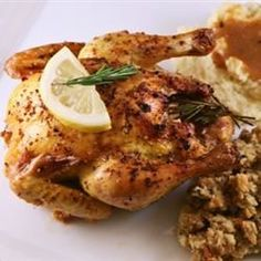Lemon- and rosemary-infused, little game hens basted with a wine and garlic broth make any occasion special.
