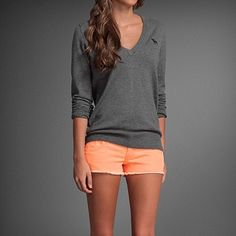 orange shorts, grey shirt. love bright bottoms with a neutral top. especially for the summer.