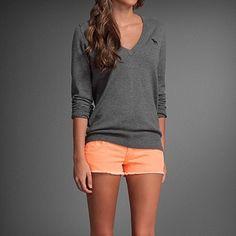 orange shorts, grey shirt ...like the color combo