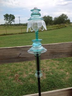 Glass Garden Totem.... Candlesticks, a small stemmed glass and a tulip bowel