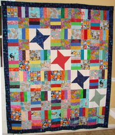 Cat themed quilt with left over friendship stars.