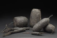 Africa    Set of 7 Tron Vodun Objects - Fon People - Benin  , Mid. 20th C. Twine, metal, sacrificial materials 8 x 5 x 4 inches 20.3 x 12.7 x 10.2 cm Af 340
