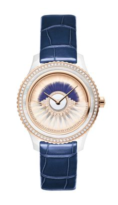 Dior VIII Grand Bal Cancan watch in a 38mm pink gold and ceramic case has a dial decorated with two rows of white and blue feather marquetry. The pink oscillating weight on the dial swings back and forwards and is set with diamonds and white feathers. Limited edition of 88 pieces.