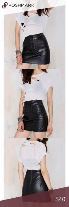 #109 nasty gal. 🐥🍂 If love is a battlefield, consider this your Battle Scar. This black vegan leather skirt features panel design, lattice design at front, and top stitching detail. Back zip closure, fully lined, enclosed seams. Team it up with the Battle Scar Crop Top, or a rocker tee and combat boots. Fight the good (lookin') fight. By Nasty Gal.  *PU/Polyester/Spandex  *Runs true to size  *Model is wearing size small  *Hand wash cold  *Imported Nasty Gal Skirts Mini