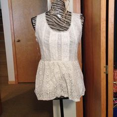 Lace peplum top Worn a couple times cute and flattering Tops Tank Tops