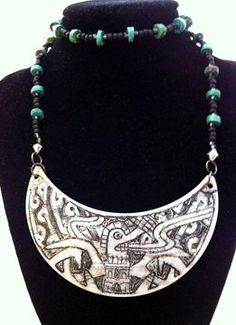 Gorgets (necklace-of the throat) Offer Insight into Early Chickasaw Culture. A gorget by Chickasaw artist Dustin Mater made of abalone shell, glass beads and turquoise.