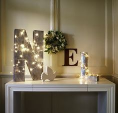 I simply love the wooden letter and tangled lights!