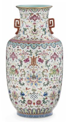 A FAMILLE ROSE BALUSTER VASE Decorated and gilt with two coral-ground handles to the shoulders, the body with shou characters amongst scrolling flowers and auspicious symbols, apocryphal Jiaqing seal mark to the base