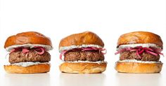 Switch up your burger game with this recipe for a lamb burger topped with herbed yogurt and pickled onions.