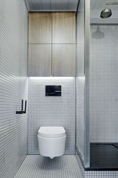 Green-grey Hisbalit tiles in Prague bathroom renovation.