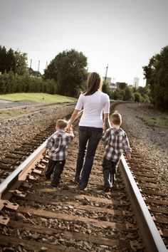 Train Tracks Pose: Portrait Creations Family Photography in South Charlotte, NC.