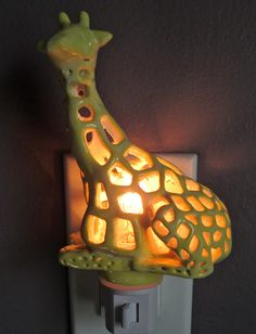 This is a hand carved ceramic item is approximately 4 1/2 inches tall and four inches wide. The giraffe was an original sculpture that was made into