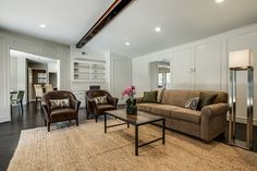 """the den with hand scraped hardwoods and painted paneling.  7th Flip - Finished """"After"""" Photos by It's Great To Be Home"""