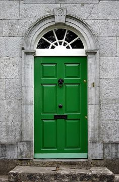 A green front door in the village square of Tyrrellspass in Ireland