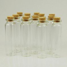 Clear empty mini glass bottle with cork stoppers. Perfect condition, great for crafting, bottle jewelry, Wicca spell bottles. Roll up your message and insert in