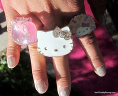 The middle Hello Kitty ring was newly released by Sephora for the Big Pink Bow collection, and opens up to reveal cream perfume scent! It smells really fruity and cute, with hints of pineapple, flowers, & coconut!