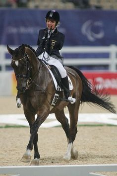 WOW. Take a closer look at that picture... yes, this woman really is riding dressage with the reins in her mouth because she doesn't have hands.