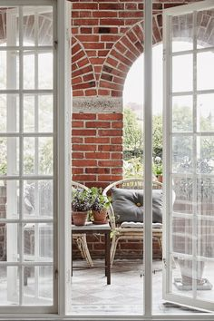 SFD0FDE2D7B20A74D8685AF4720C9D5AA59_2200x Interior And Exterior, Interior Barn Doors, Porches, Brick Arch, Brick Wall, Sweden House, Outdoor Rooms, Outdoor Living, Exposed Brick