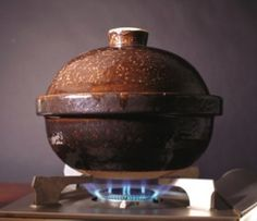 Donabe, the traditional Japanese clay pot cooker, are lidded earthen pots perfect for making rice, soups, sukiyaki, shabu shabu and braised meats and stews can be used directly on the stove or in the oven. Naoko Moore is the sole distributor of Nagatani donabe, which have been made in Iga, Japan, since the 1800s prized for its porous quality, which helps the vessels retain and distribute heat evenly. The most popular model, Kamado-san, makes rice better than any electric or stove-top cooker.