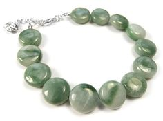 A plain gemstone and sterling silver bracelet made from smooth and glossy jade coins. We've kept it very simple and it fastens with a small lobster clasp. Sterling Silver Bracelets, Bracelet Making, Gemstone Jewelry, Turquoise Bracelet, Jade, Indigo, Coins, Beaded Necklace, Gemstones